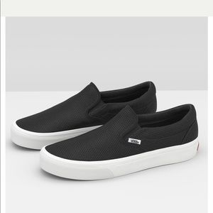 Vans black perforated leather classic slip-ons